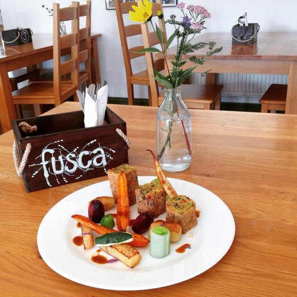 Fusca cafe spiced lentil and asparagus cake with maple roasted root vegetables and Rosemary flower gravy.